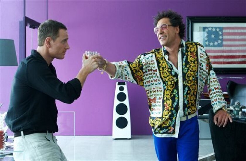 """This photo released by Twentieth Century Fox shows Michael Fassbender, left, as The Counselor, and Javier Bardem, as Reiner, in the film, """"The Counselor."""" (AP Photo/Copyright Twentieth Century Fox, Kerry Brown)"""