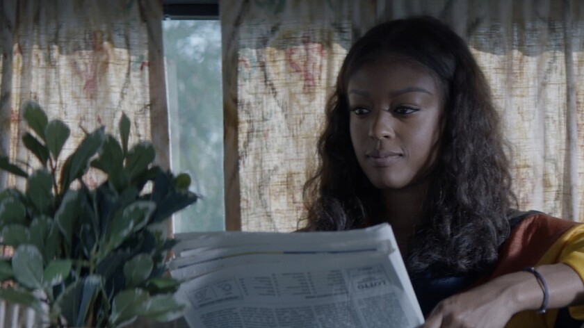 Javicia Leslie as Ryan holding a diary