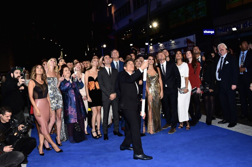 """Ben Stiller, center, uses the world's longest selfie stick to take a picture of """"Zoolander 2"""" cast and crew members and guests at the London premiere of the movie."""