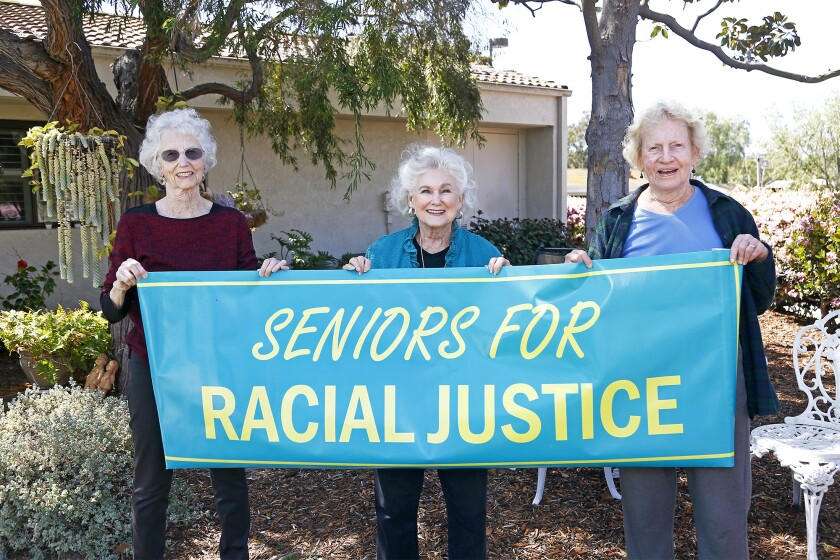 Irvine residents Jan Wilson, 74, Vivian Johnson, 85, and Francesca Cancian, 83, of Seniors for Racial Justice.
