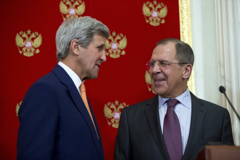 Secretary of State John Kerry and Russian Foreign Minister Sergey Lavrov speak together following a news conference at the Kremlin in Moscow, Russia, Friday, March 25, 2016, following a meeting with Russian President Vladimir Putin. (AP Photo/Andrew Harnik, Pool)