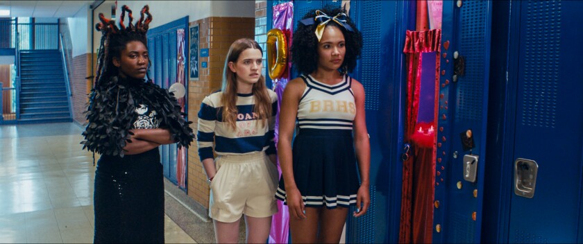 """Ireon Roach, left, Grace Smith and Kayla Carter stand near decorated lockers in a high school hallway in """"Knives and Skin."""""""