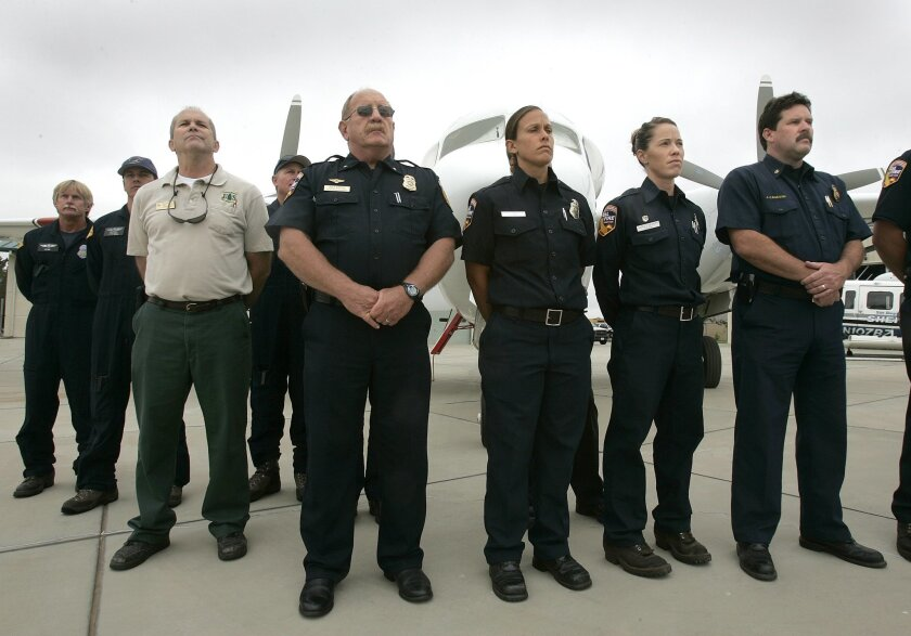 Firefighting pilots gathered for a briefing yesterday to coordinate wildfire response.  John Gastaldo / Union-Tribune photos