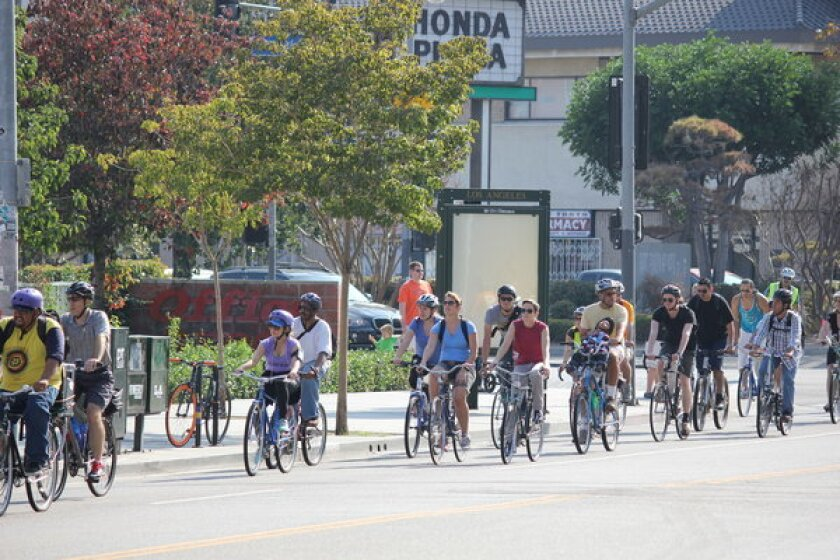 Cyclists complete their end-to-end ride up Los Angeles' Central Avenue on Nov. 3.