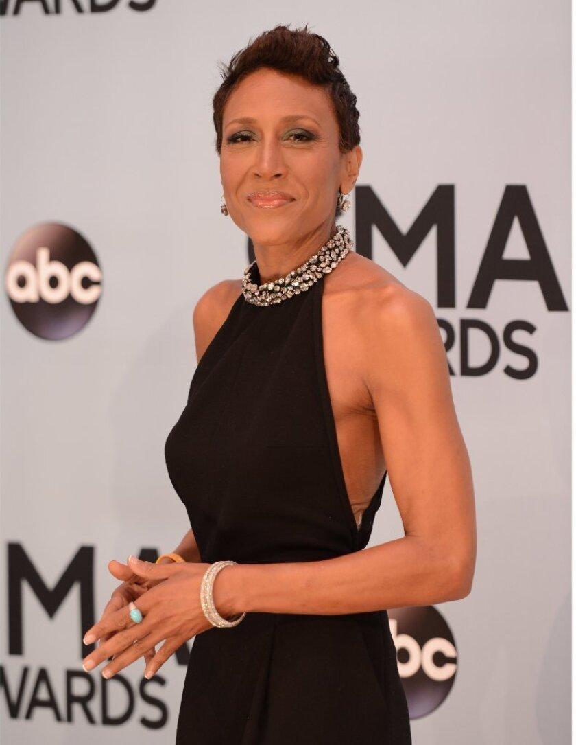 """Good Morning America"" co-host Robin Roberts arrives at the 47th annual CMA Awards on Wednesday, Nov. 6, 2013, in Nashville, Tenn."