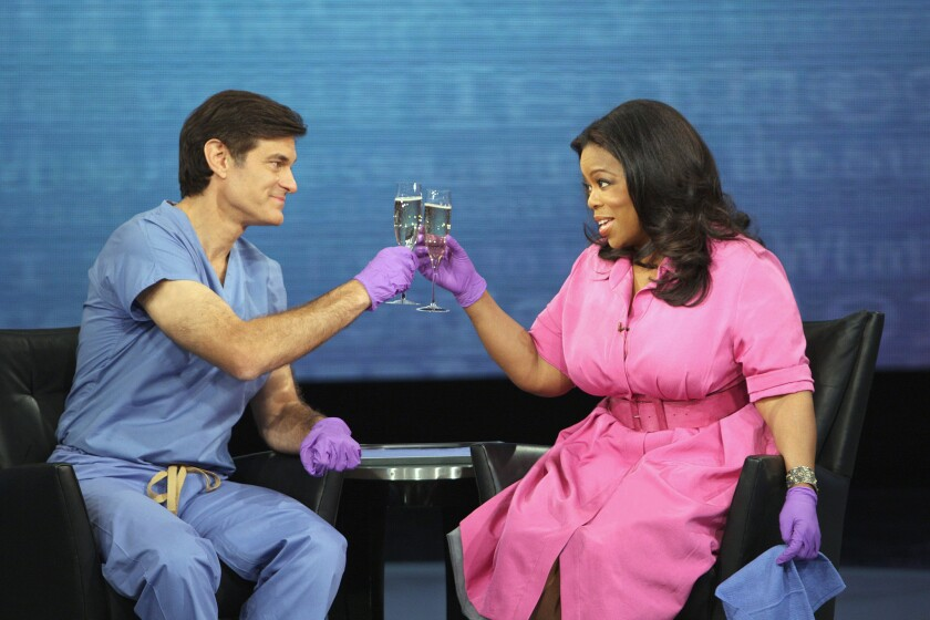 Toasting their profits from fooling the American public? Dr. Oz (left) and his prime enabler, Oprah Winfrey.