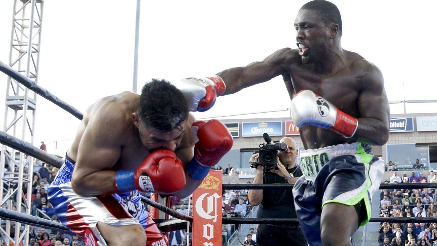 Victor Ortiz, left, can't evade a punch by Andre Berto during the fourth round of their welterweight fight Saturday night at StubHub Center.
