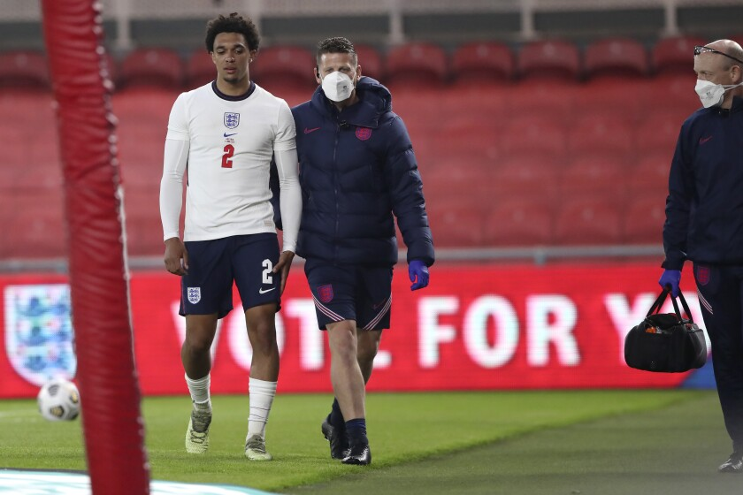 England's Trent Alexander-Arnold walks out of pitch after an injury during the international friendly soccer match between England and Austria at the Riverside stadium in Middlesbrough, England, Wednesday June 2, 2021. (AP Photo/Scott Heppell, Pool)