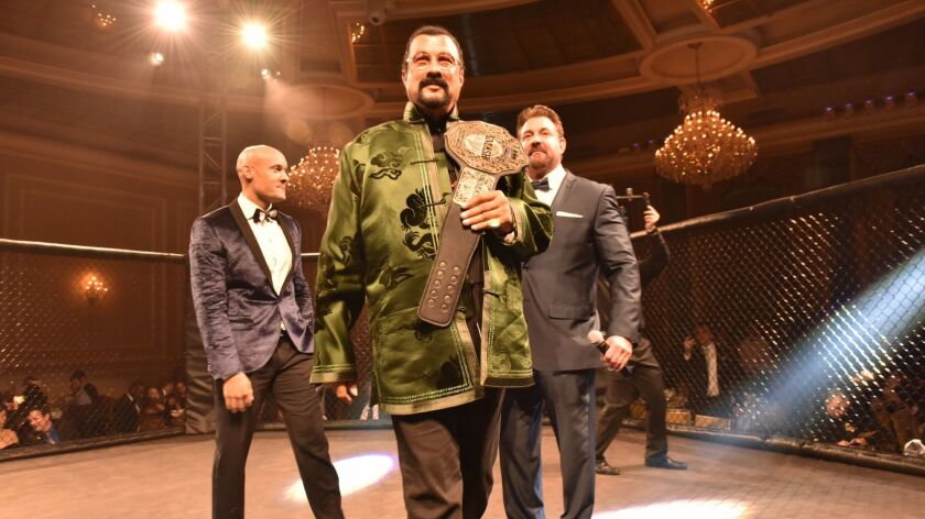 Steven Seagal is honored in the MMA octagon at the SMASH Global Pre-Oscars Gala in Hollywood.
