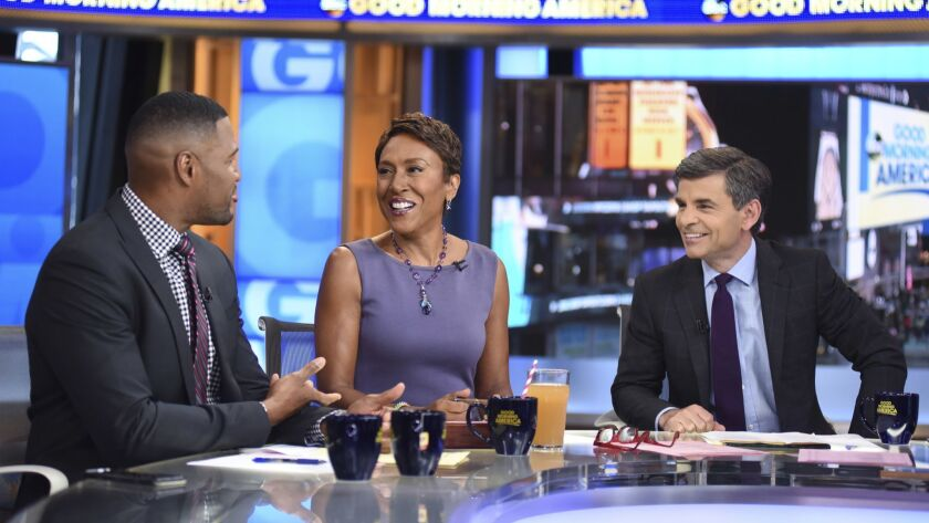 "From left, Michael Strahan, Robin Roberts and George Stephanopoulos on the set of ""Good Morning America,"" in 2018."