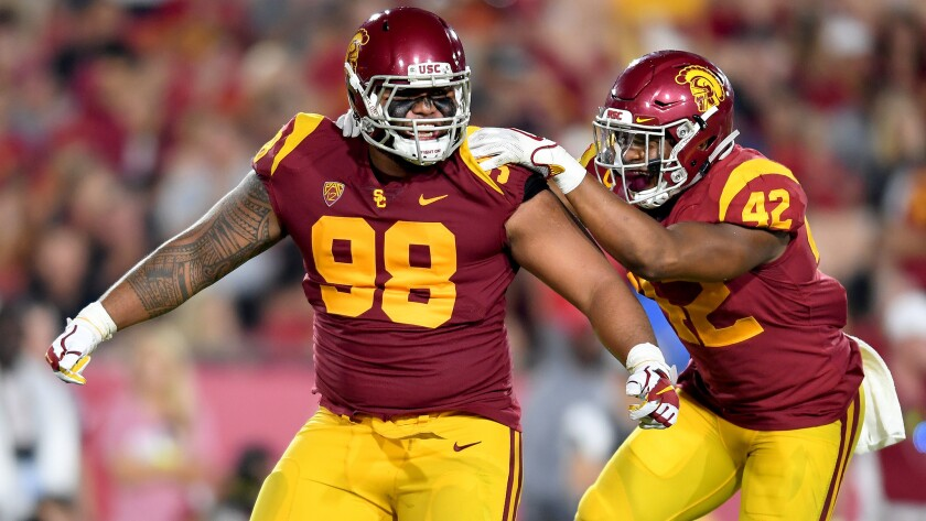 LOS ANGELES, CALIFORNIA SEPTEMBER 9, 2017-USC's Josh Fatu, left, celebrates his sack on Stanford qua