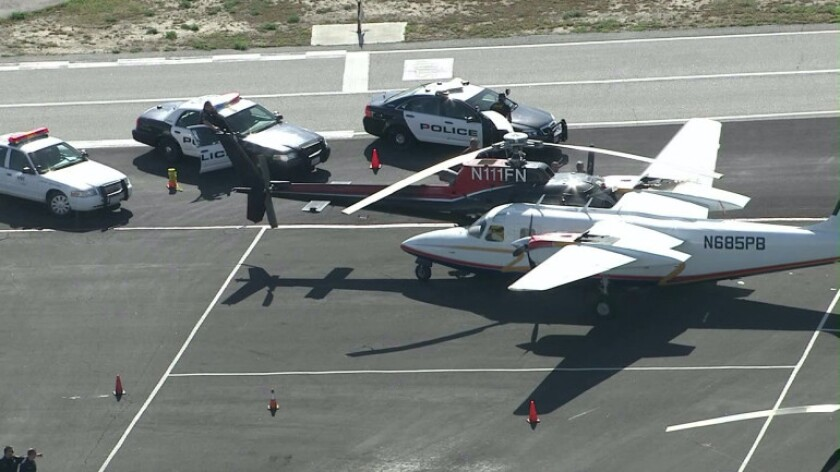 A plane and a helicopter collided Thursday afternoon at the Van Nuys Airport, authorities said.