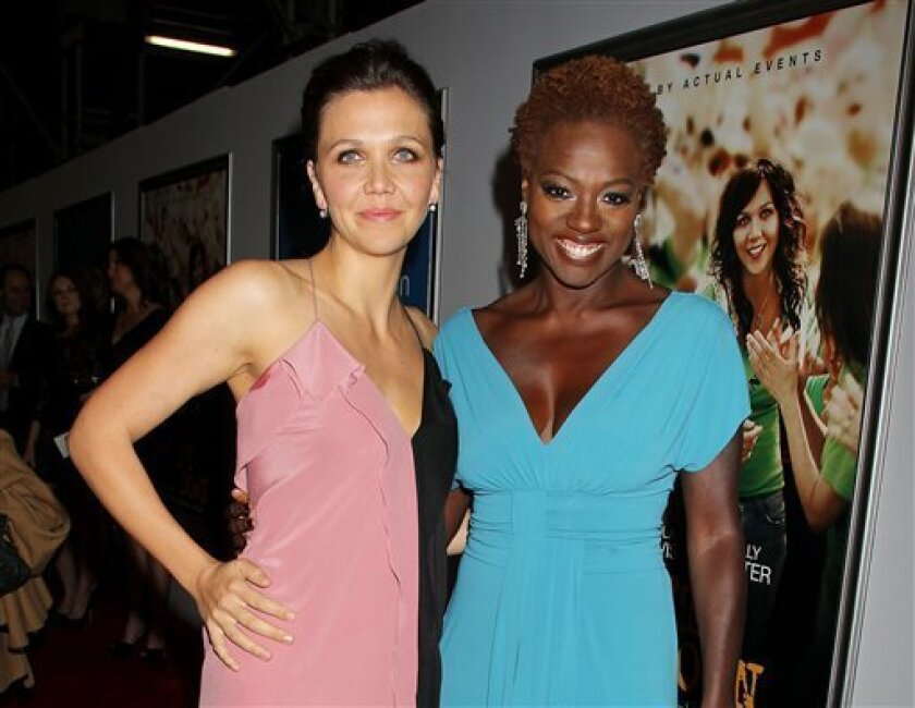 """FILE - This Sept. 23, 2012 file photo released by Starpix shows actress Maggie Gyllenhaal, left, and Viola Davis at the premiere of their film """"Won't Back Down,"""" in New York. The movie was a box-office dud, but its creators have more than ticket sales in mind.  They hope the classroom drama about t"""