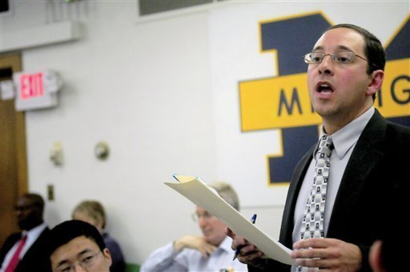 """FILE - In this Sept. 7, 2010 file photo, University of Michigan alumnus and state assistant attorney general Andrew Shirvell speaks about the University of Michigan's student assembly president Chris Armstrong at a Michigan Student Assembly meeting in Ann Arbor, Mich. Shirvell went on leave a month ago after national criticism erupted over a blog he wrote characterizing Armstrong as a """"racist"""" and """"liar"""" who promoted a """"radical homosexual agenda."""" He returned to the attorney general's office Friday, Nov. 5, and was scheduled for a disciplinary hearing. (AP Photo/The Michigan Daily, Marissa McClain) MANDATORY CREDIT"""