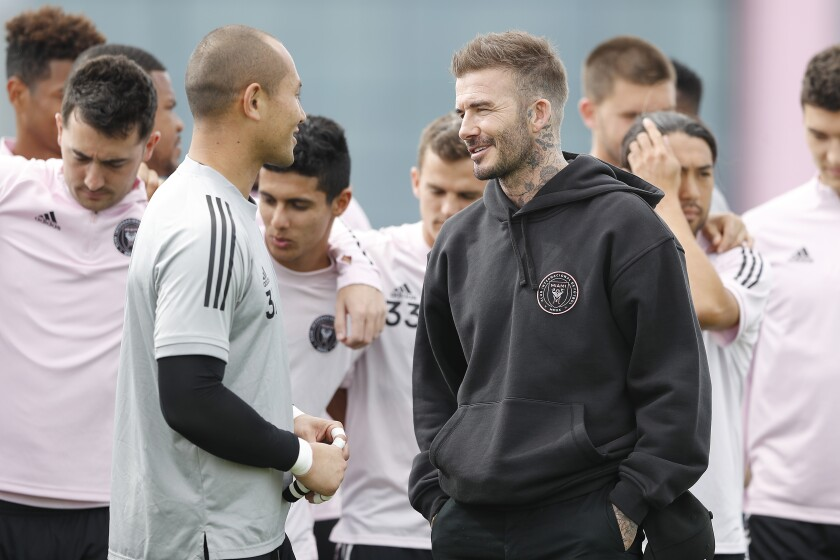 David Beckham, the owner and president of soccer operations for Inter Miami CF, speaks with the team's goalkeeper, Luis Robles, during a team media session on Feb. 25.