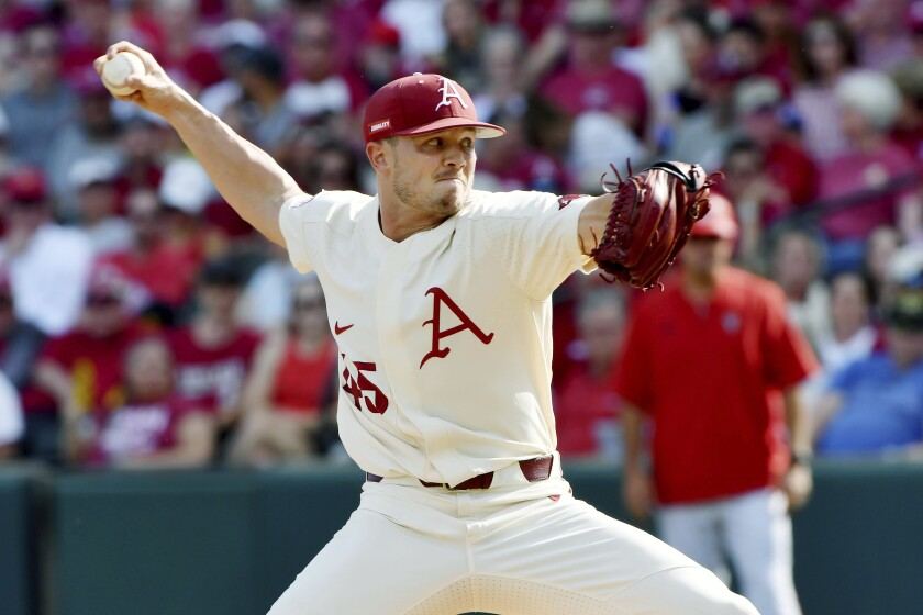 Arkansas pitcher Kevin Kopps (45) throws against North Carolina State in the second inning of an NCAA college baseball super regional game, Sunday, June 13, 2021, in Fayetteville, Ark. (AP Photo/Michael Woods)
