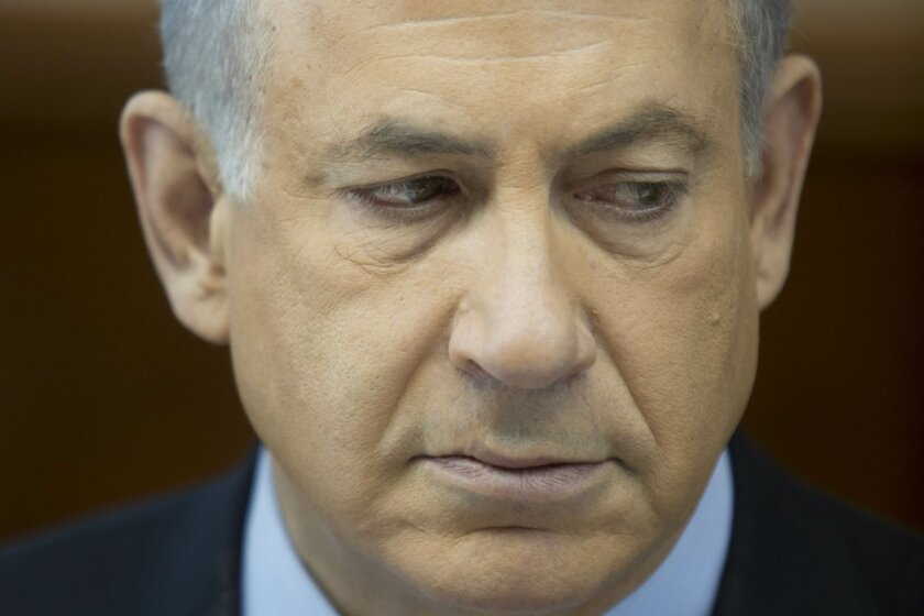 FILE - In this Nov. 24, 2013 file photo, Israeli Prime Minister Benjamin Netanyahu attends the weekly cabinet meeting at his office in Jerusalem. Natanyahu's brothers nicknamed him Bibi when he was a kid. (AP Photo/Abir Sultan, File)