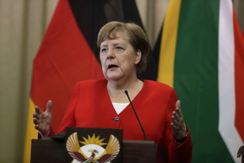 German Chancellor Angela Merkel speaks during a press conference with South African President Cyril Ramaphosa, at the government's Union Buildings in Pretoria, South Africa, Thursday, Feb. 6, 2020. Merkel is in South Africa to discuss trade, investment and energy issues with Berlin's largest trading partner in Africa. (AP Photo/Themba Hadebe)