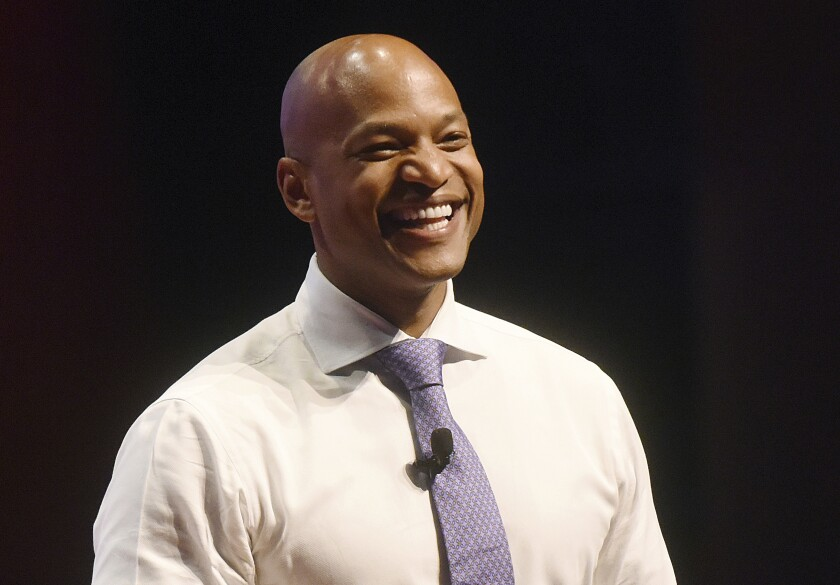 FILE - In this Nov. 14, 2018 file photo, Author and CEO of the Robin Hood foundation, Wes Moore, answers questions during a question and answer session during The Economic Club of Southwestern Michigan Speakers Series at Lake Michigan College in Benton Harbor, Mich. The CEOs of Starbucks and Goldman Sachs will join leaders from philanthropy and academia in a new initiative to address the racial wealth gap in the United States. The initiative is called NinetyToZero, so-named for the roughly 90% wealth gap between white and Black Americans.(Don Campbell/The Herald-Palladium via AP)