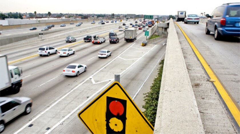 TRAFFIC: L.A. County transportation officials say that if they can win a huge U.S. grant, rush-hour toll lanes could become a reality on three local freeways, including the 110, above, by spring 2009.