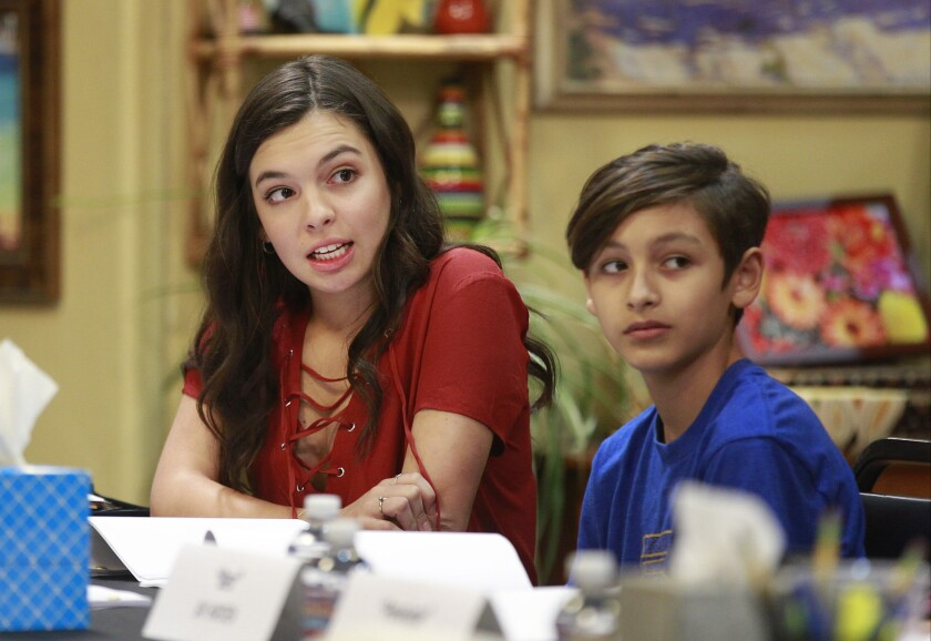 "In an episode of Netflix's ""One Day at a Time,"" the character played by Marcel Ruiz, right, is told to ""go back to Mexico."" His lighter-skinned sister, portrayed by Isabella Gomez, says she's been spared from such attacks."