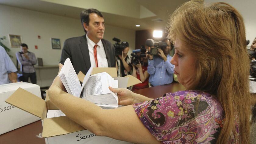 Tim Draper, seen filing petitions in Sacramento in 2014, tried to get an initiative on the ballot to split California into six states.