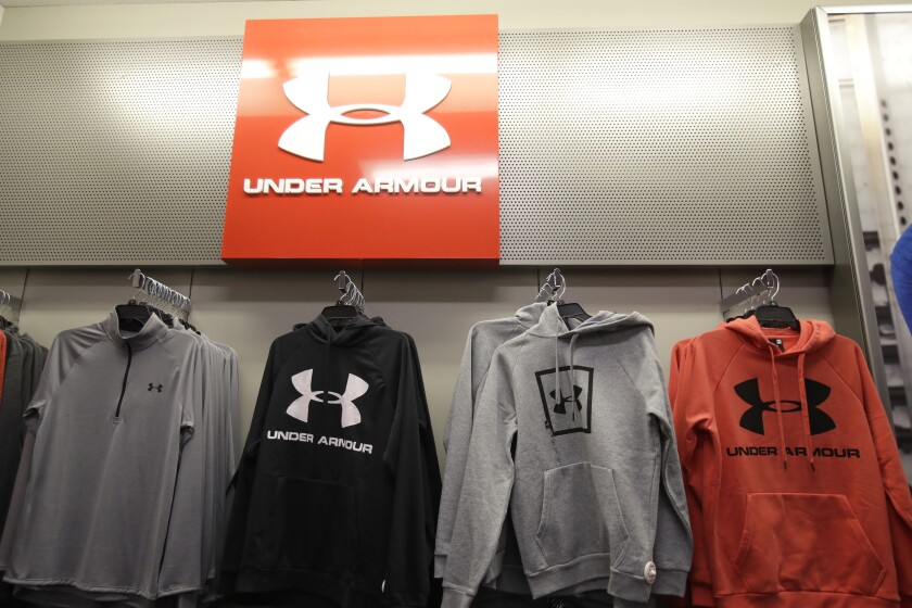 FILE - In this Nov. 29, 2019, file photo Under Armour clothes are displayed at a Kohl's store in Colma, Calif. Sportswear company Under Armour has settled with the Securities and Exchange Commission to pay $9 million in fines related to misleading its revenue growth to investors from the third quarter of 2015 through the fourth quarter of 2016, the agency said Monday, May 3, 2021. (AP Photo/Jeff Chiu, File)