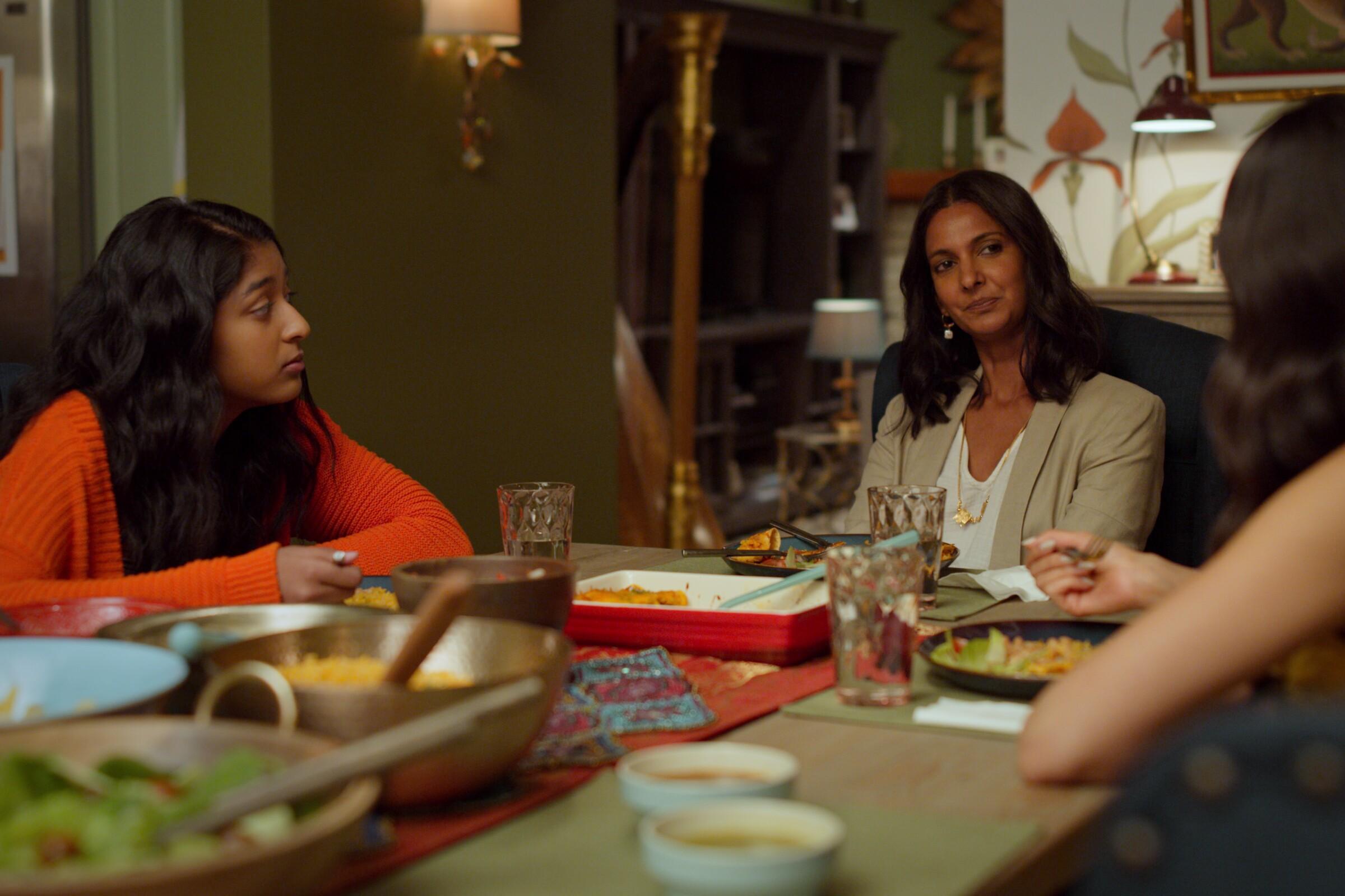 "Maitreyi Ramakrishnan, left, Poorna Jagannathan and Richa Moorjani in a scene from ""Never Have I Ever."""