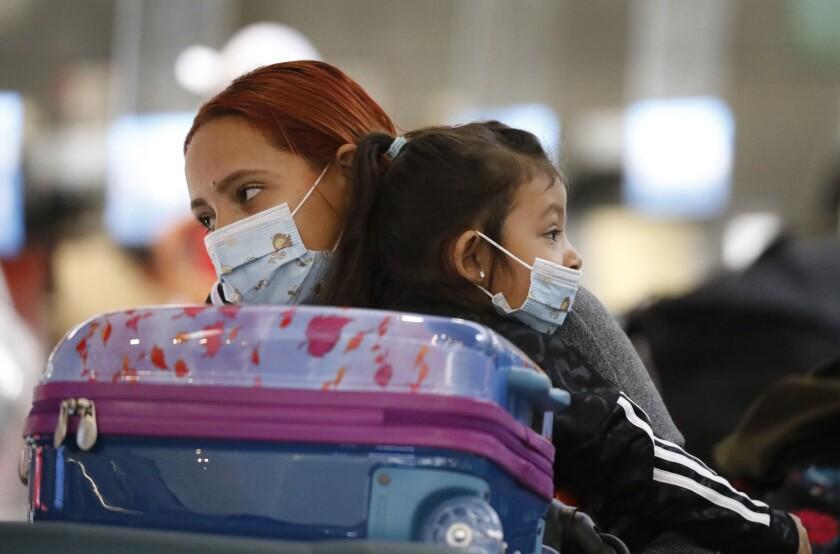 Karen Alvarez comforts her 3-year-old daughter, Mercedez Gomez.
