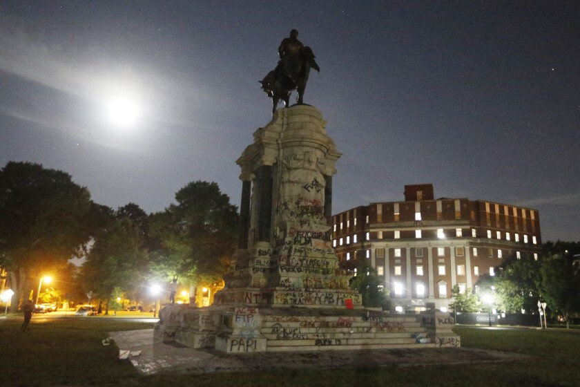 The Moon illuminates the statue of Confederate General Robert E. Lee on Monument Avenue Friday June. 5, 2020, in Richmond, Va. Virginia Gov. Ralph Northam has ordered the removal of the statue. (AP Photo/Steve Helber)