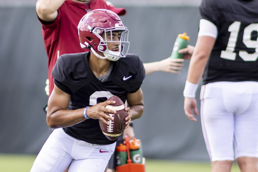 Alabama quarterback Bryce Young (9) rolls out on a passing drill