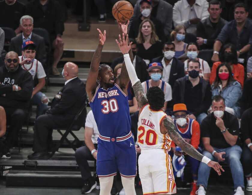 New York Knicks forward Julius Randle (30) takes a 3-point shot in the first quarter against the Atlanta Hawks in Game 5 of an NBA basketball first-round playoff series Wednesday, June 2, 2021, in New York. (Wendell Cruz/Pool Photo via AP)