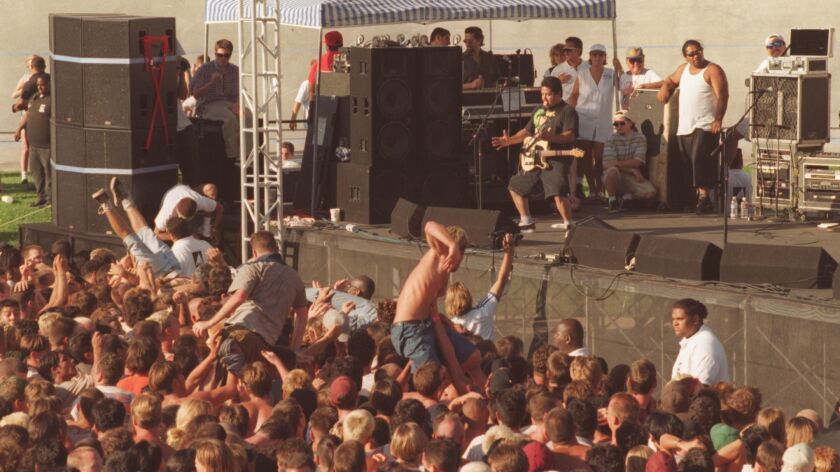 CA.Warped.#5.pr.7/6/96 CARSON–– Bodies surf above the crowd as NOFX performs at the Warped Tour conc