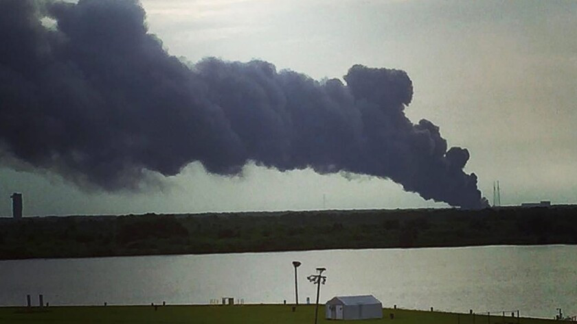 A trail of smoke leads to the remains of a SpaceX Falcon 9 rocket after it exploded Sept. 1.