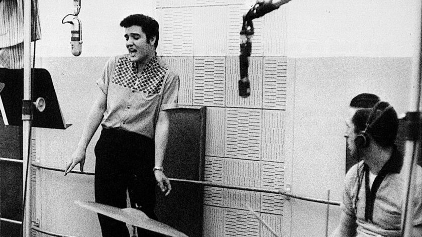 "Elvis Presley recording with drummer D.J. Fontana at the ""Jailhouse Rock"" session in 1957 at Radio Recorders studio in Hollywood."