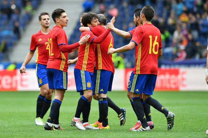 Spain's  players celebrate after scoring during a friendly soccer match between Spain and South Korea in Salzburg, Austria, Wednesday, June 1, 2016. The Spain National Football Team is in Austria for a training camp in preparation for the  EURO 2016 soccer championships, hosted by France.(AP Photo/