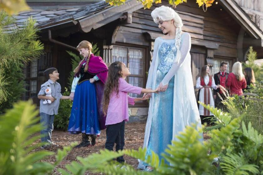 """""""Frozen"""" characters Anna, left, and Elsa will take Disney Cruise Line passengers on shore excursions in Alesund, Norway, this summer."""