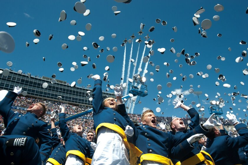 "The Air Force Thunderbirds fly overhead as graduating cadets celebrate with the ""hat toss"" after graduation ceremonies at the 2016 class of the U.S. Air Force Academy, Thursday, June 2, 2016, in Colorado Springs, Colo. A Thunderbirds jet crashed after a flyover of the academy commencement attended"