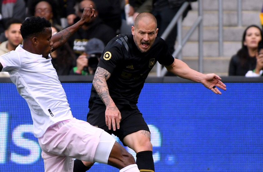 LAFC defender Jordan Harvey reacts after Inter Miami's Alvas Powell blocks his pass during LAFC's season opener on March 1.