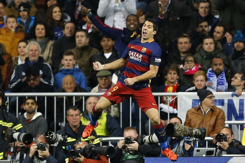 FILE - In this Nov. 21, 2015 file photo, Barcelona's Luis Suarez celebrates after scoring the opening goal during the first clasico of the season between Real Madrid and Barcelona at the Santiago Bernabeu stadium in Madrid, Spain. The rivalry between Real Madrid and Barcelona is heating up before a