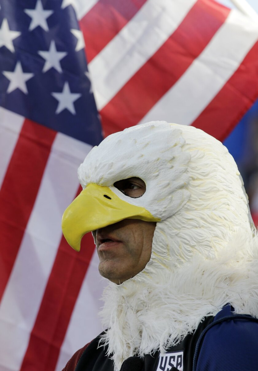 A soccer fan, wearing an eagle hood, waits for an international friendly soccer match between the United States and Bolivia, Saturday, May. 28, 2016, in Kansas City, Kan. (AP Photo/Colin E. Braley)
