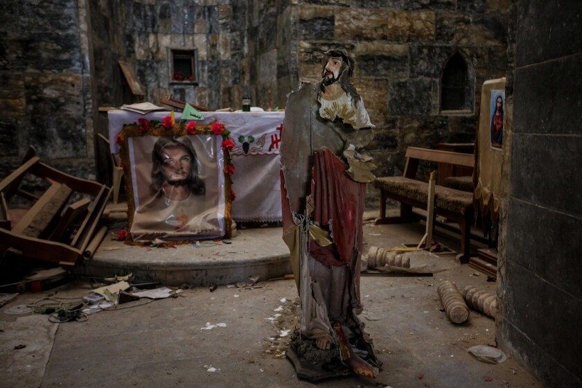 A prayer chamber is destroyed at St Mary Tahira in Qaraqosh, Iraq, where Islamic State militants took over it and used the courtyard as a firing range.