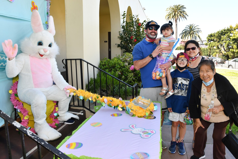 Shane Masek, Nivea Macias, Jaxson Masek, Maria Masek and her mother (also Maria) visit the Recreation Center's spring bunny.
