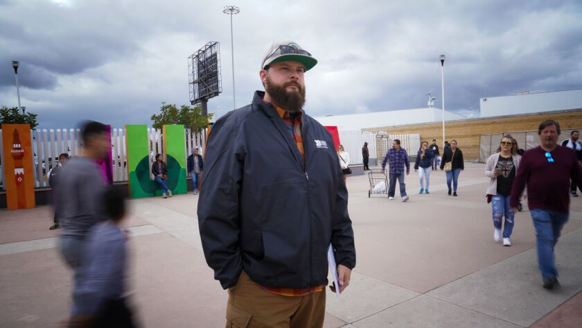 James Cordero stands at the entrance to the port of entry at El Chaparral in Mexico. On two separat