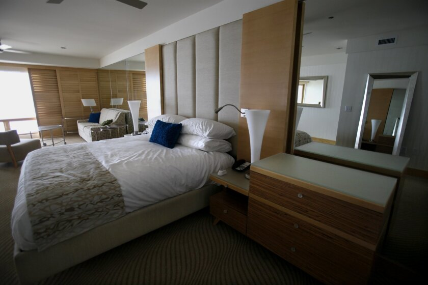 Furnishings in a nearly complete model room at Pier South are sand colored and have a slightly retro design. The hotel is under construction in Imperial Beach. Peggy Peattie • U-T