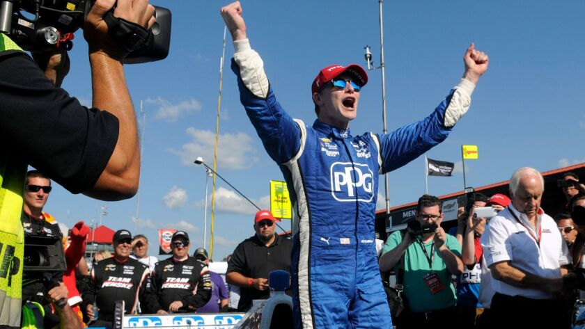 IndyCar driver Josef Newgarden celebrates after winning the Honda Indy 200 at Mid-Ohio Sports Car Course on Sunday.