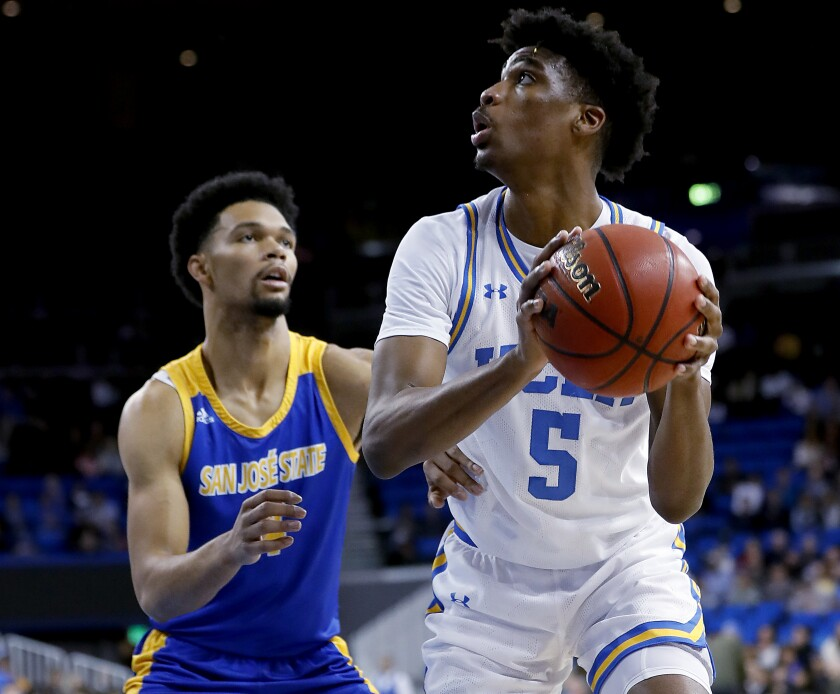 UCLA guard Chris Smith drives to the basket against San Jose State guard Zach Chappell during the first half of a game Dec. 1 at Pauley Pavilion.