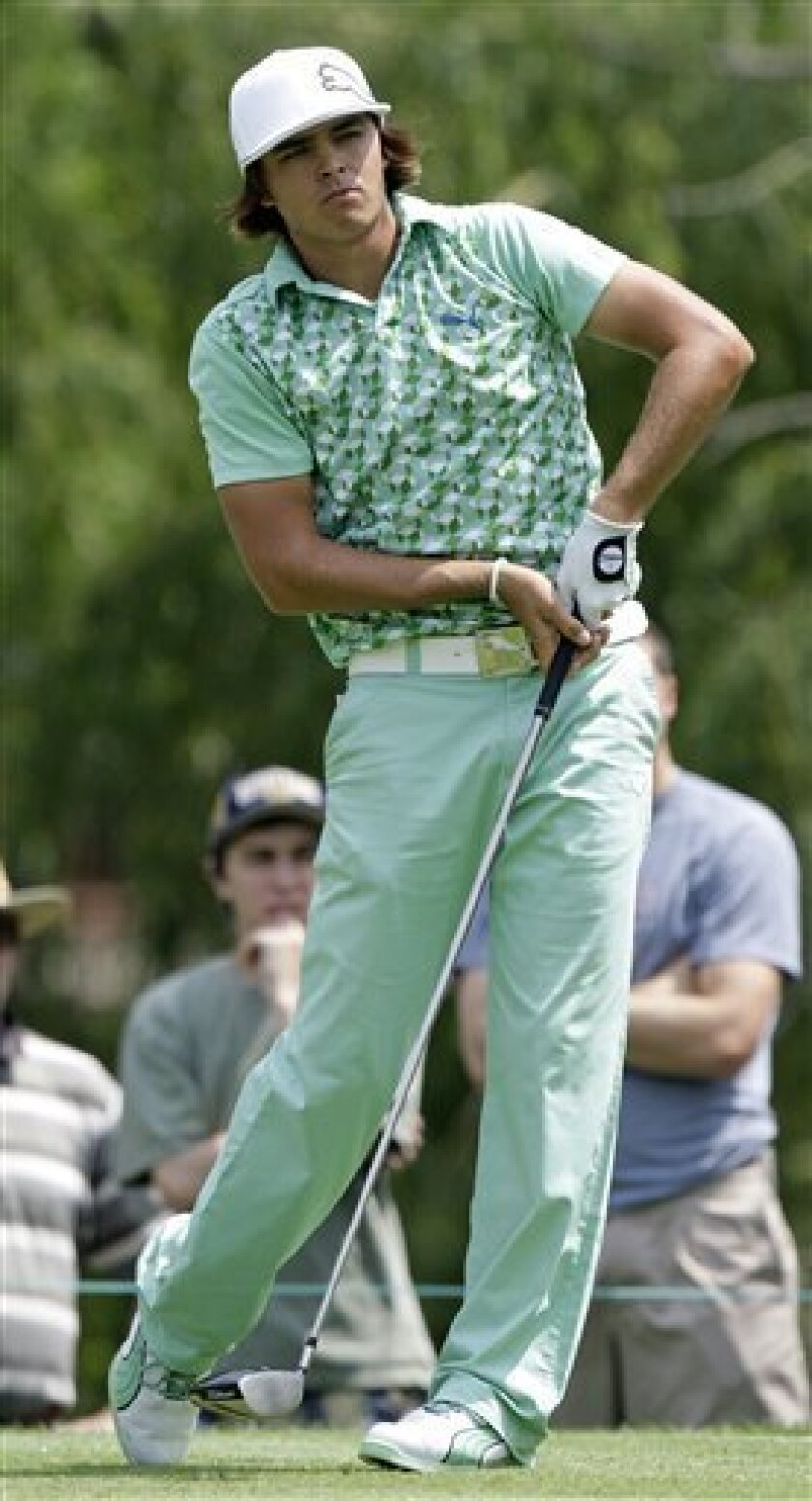 Rickie Fowler watches his tee shot on the par-4 ninth hole during the second round of The Memorial golf tournament at Muirfield Village Golf Club Friday, June 4, 2010, in Dublin, Ohio. Fowler parred the hole. (AP Photo/Jay LaPrete)