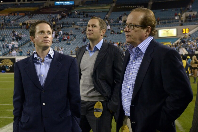 Chargers Chairman Dean Spanos, right, and his sons John Spanos, left, and A.G. Spanos, watch from the sideline during the second half of a 2011 game at Jacksonville.