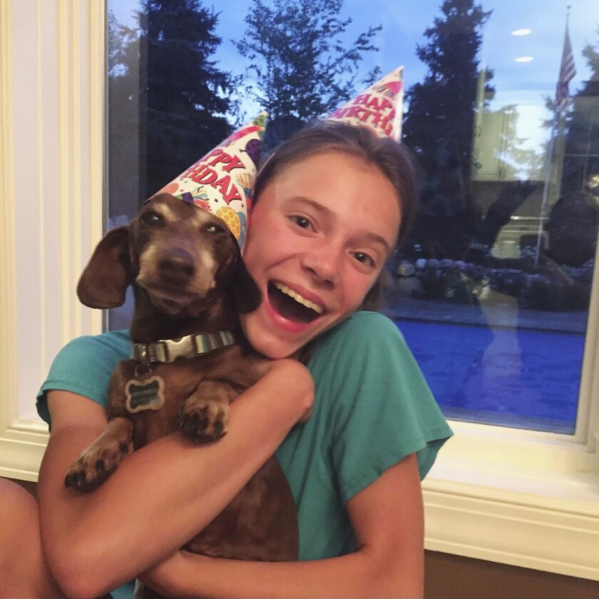 Peyton Crest with her dog at home in Minnetonka, Minn.